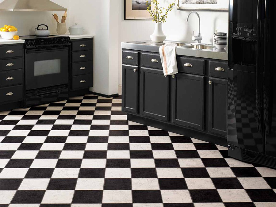 Black and white checkered mosaic tile floor in kitchen