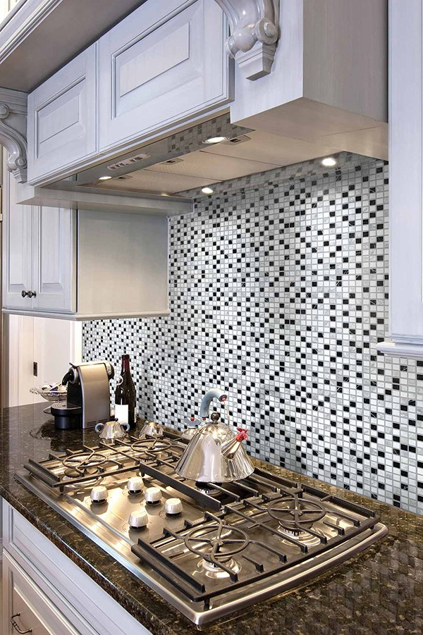Kitchen stove with mosaic tile backsplash