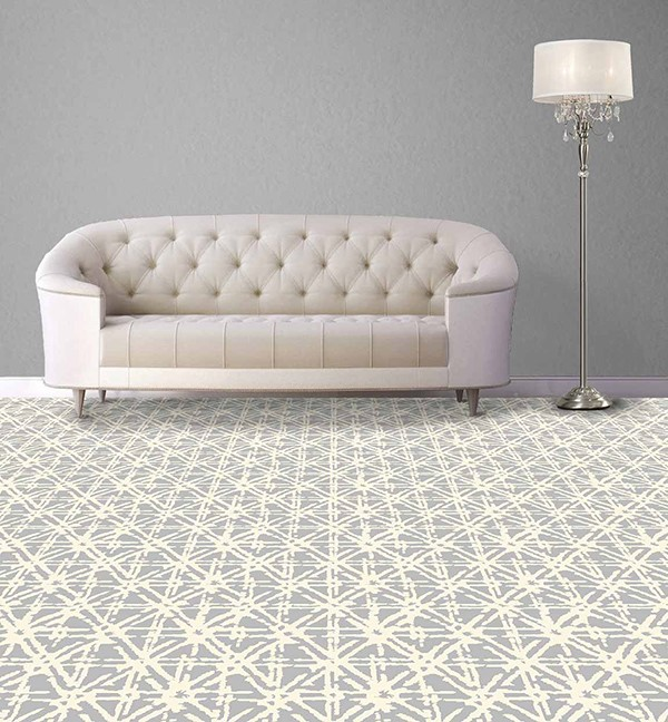 Light colored carpet with cross pattern in a living room with a white couch
