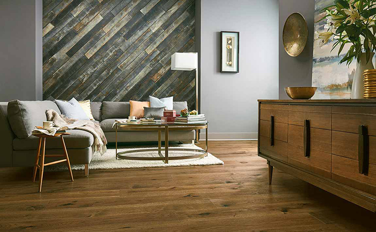 Modern living room with a distressed wood feature wall