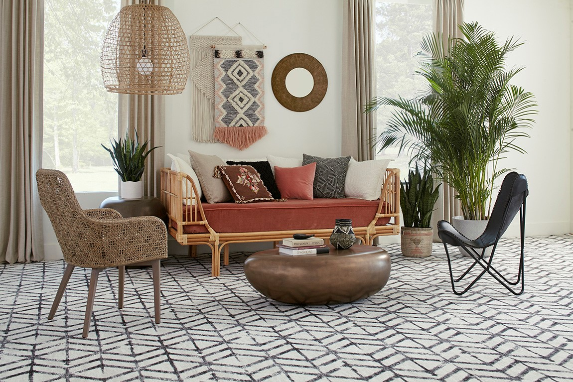 living room with patterned carpet flooring